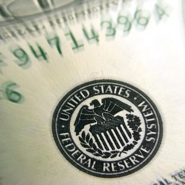 Dolar odreagowuje po mętnym komunikacie FED